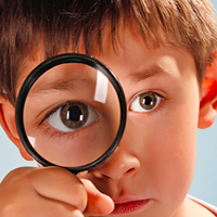 Boy with magnifying glass photo